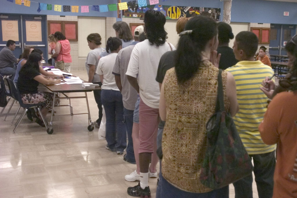 Applicants line up for registration at one of our evening legal clinics.